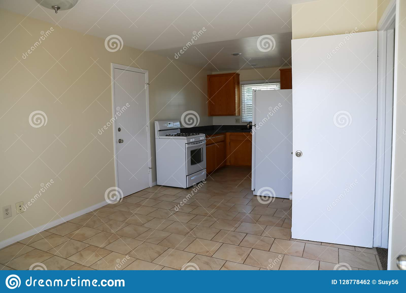 Simple Kitchen With Range Cabinets Refrigerator Tile Floor Stock