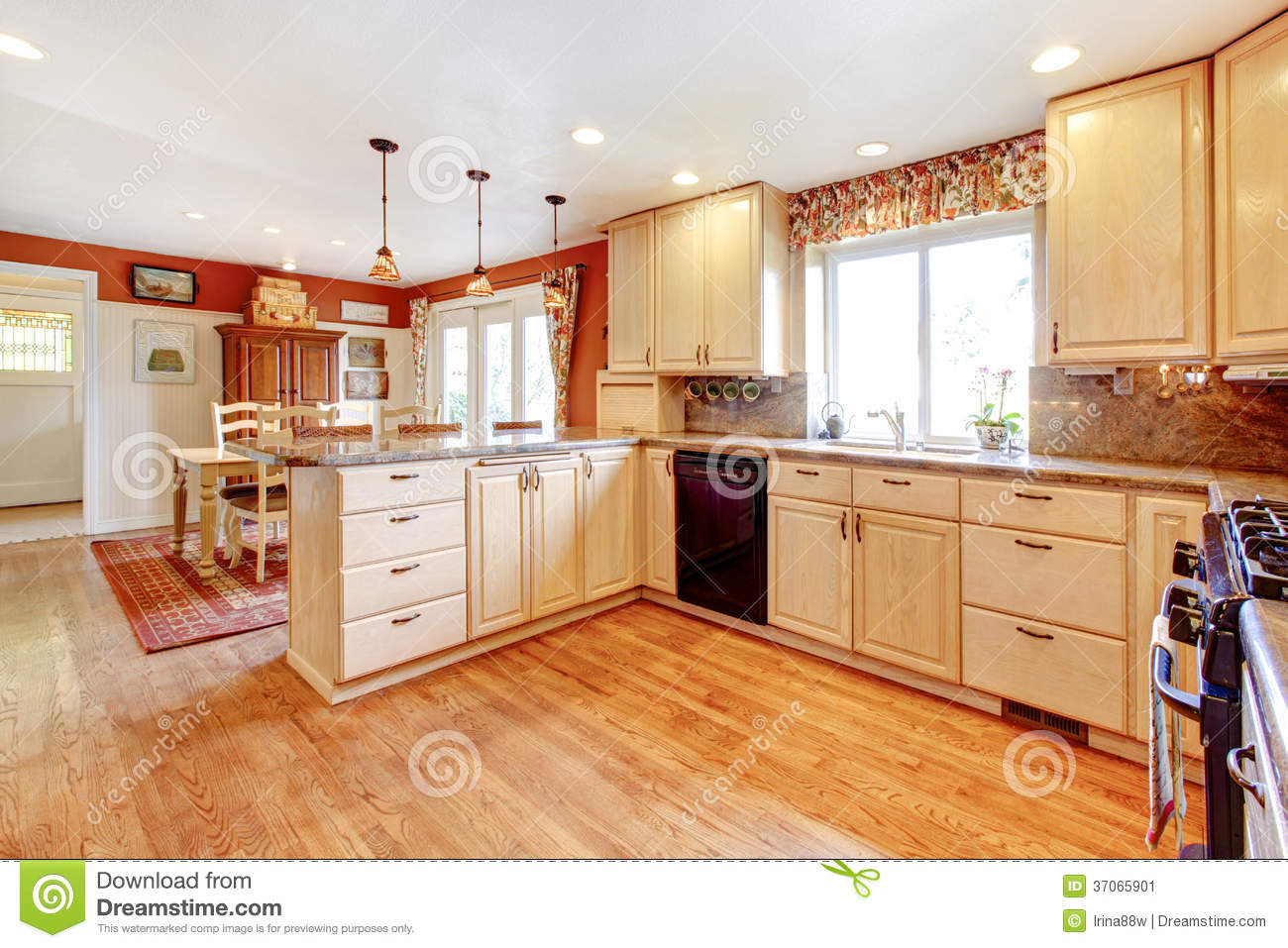 Pretty Bright Small Kitchen Color For Apartment Simple Warm Colors Kitchen Room With A Small Dining Area Stock Image