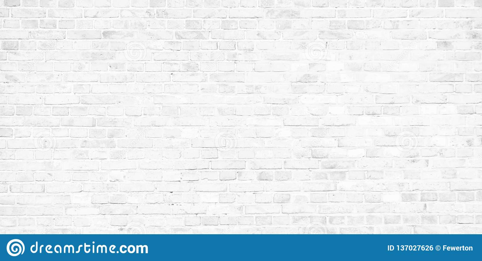 Simple white brick wall with light gray shades seamless pattern surface texture background in banner wide panorama