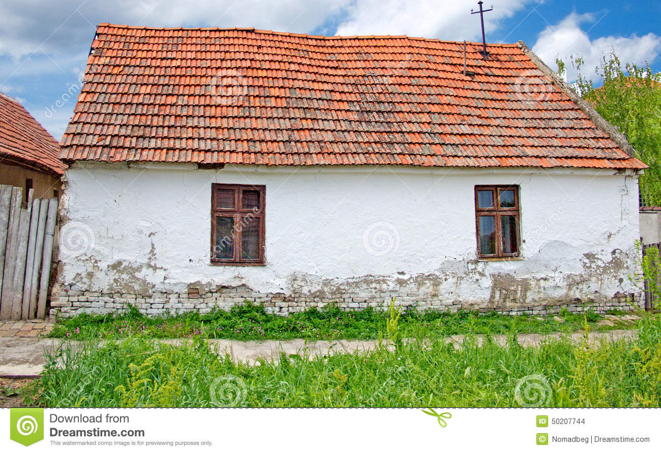 Simple white farmhouse with a red roof stock photo image for Country farm simples