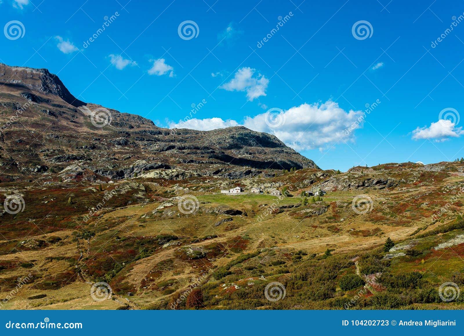 Simplon pass, alpine landscape of a mountain pass with church an