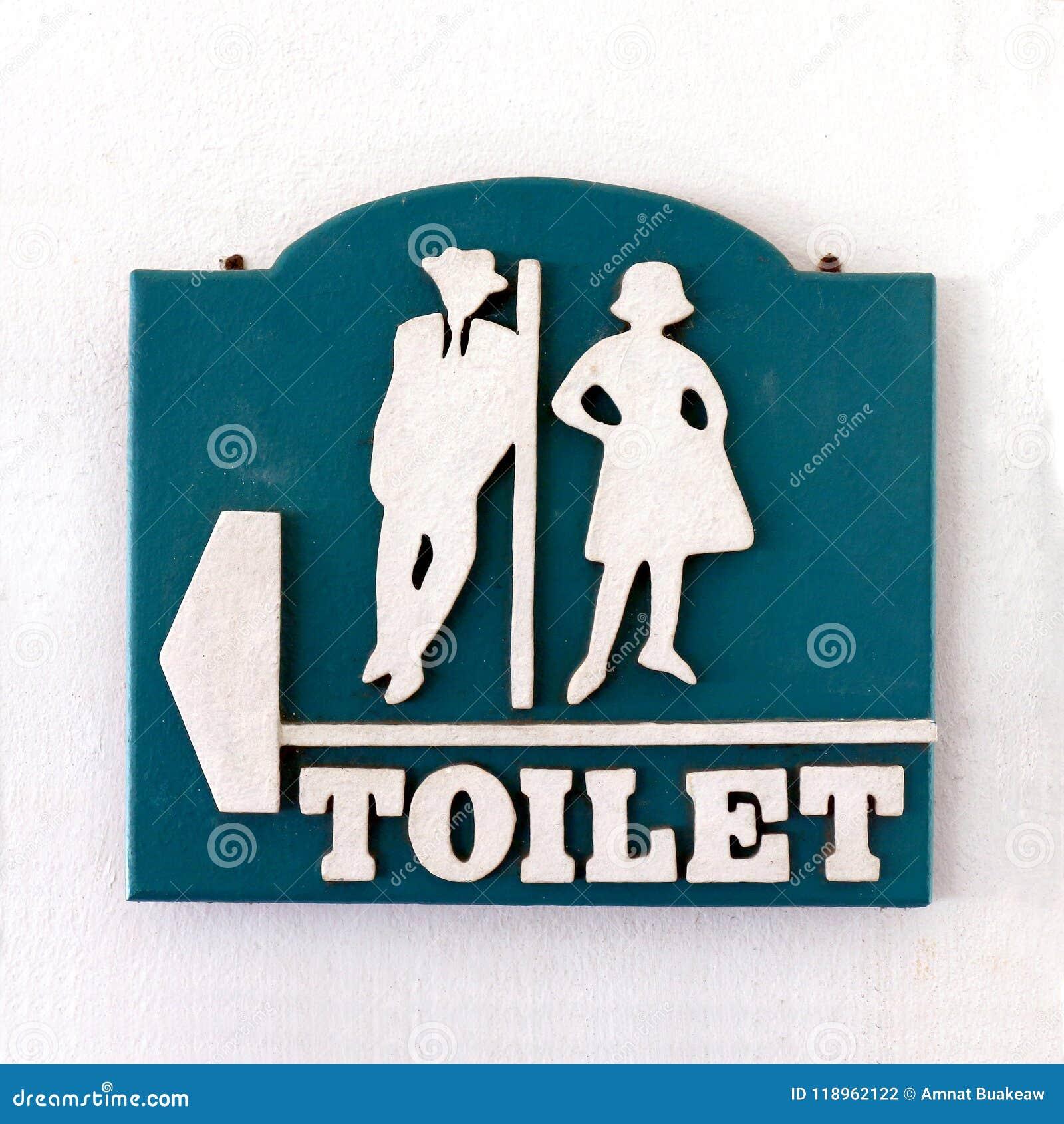 Sinal do banheiro, estilo velho homem-fêmea do vintage do toalete público do sinal na parede do cimento branco, sinal do toalete