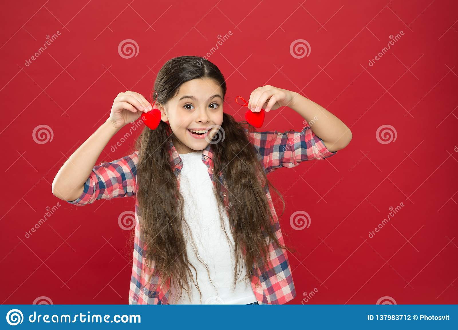Sincere love. Be my valentine. Family love. Girl cute child with hearts. Kid girl with long hair red background