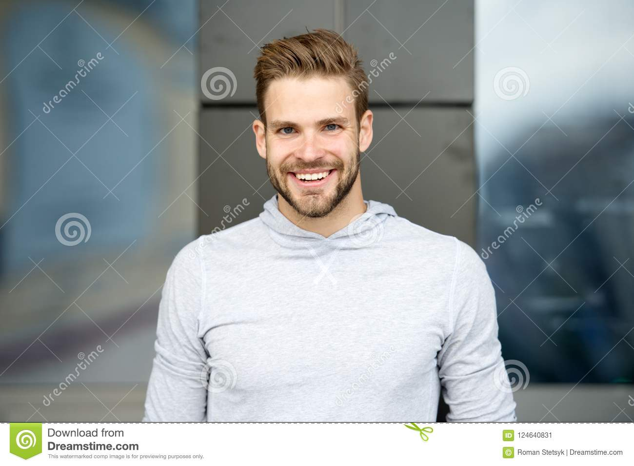 Sincere smile concept. Man with perfect brilliant smile unshaven face urban background. Guy happy emotional expression