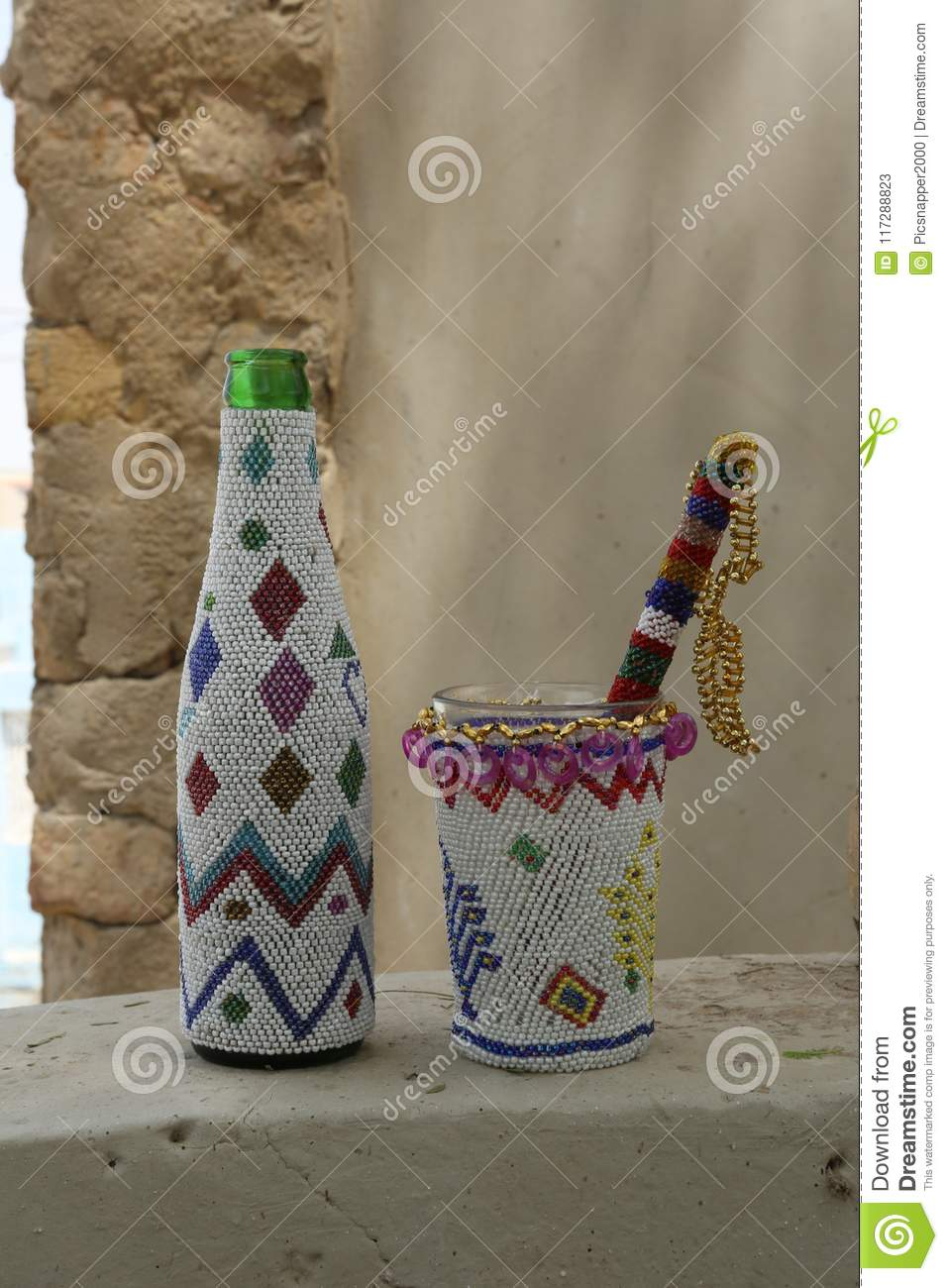 Sindhi Artisan Handicrafts Beaded Casings For Bottle And Mortar And