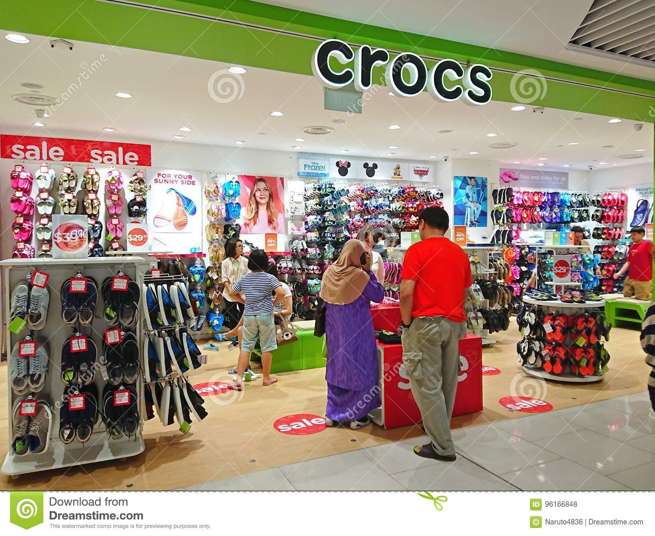 6a0ffacee 1 of the many Crocs retail store in Singapore . Shoppers checking out items  that are on display .