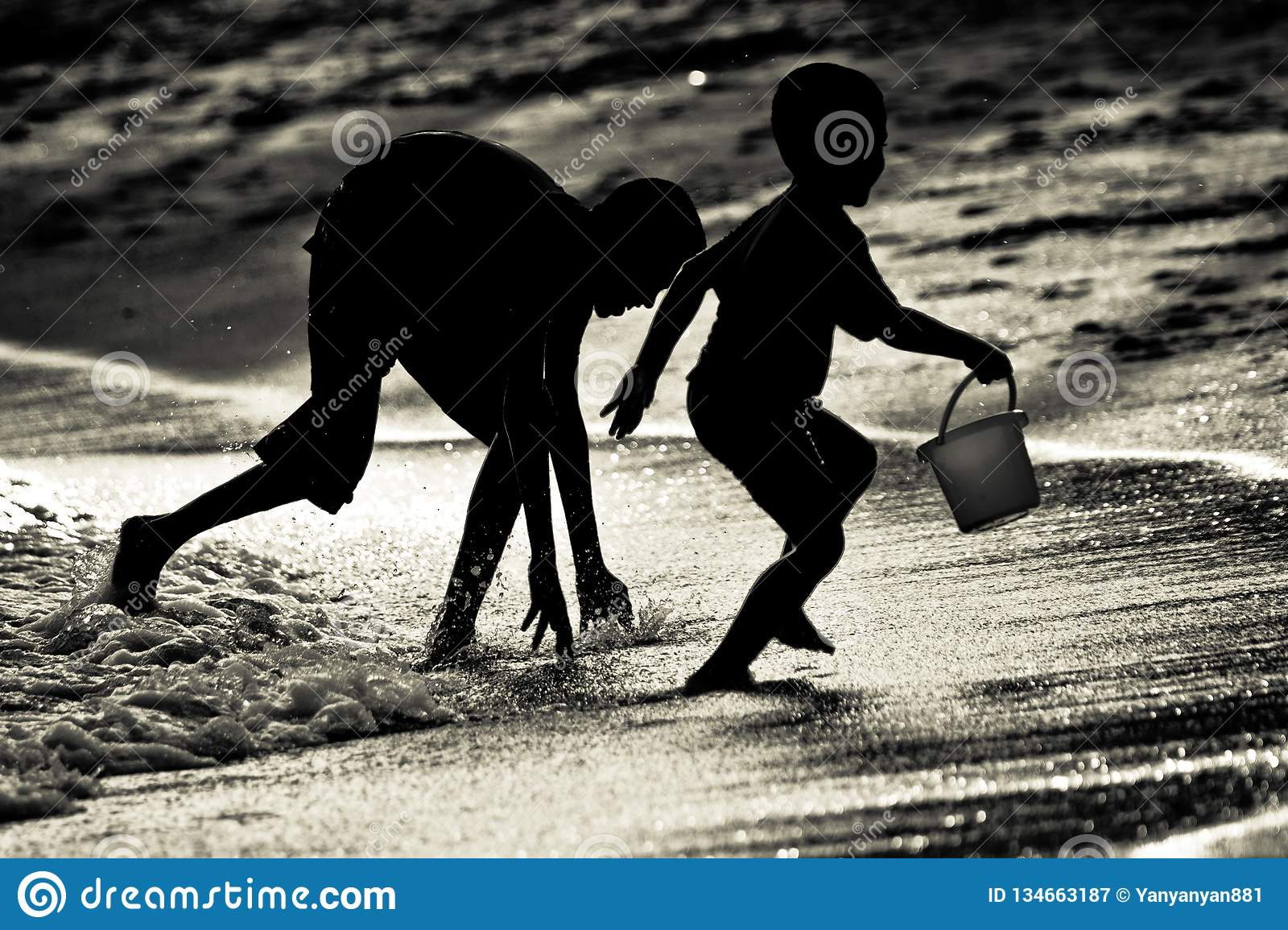 Siblings brothers playing catching at a beach in Singapore