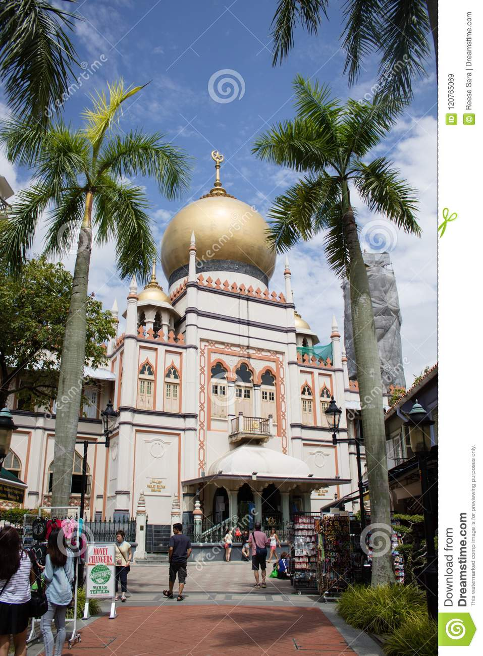 Singapore - 30 Jan 2015: Tourists are walking around Sultan Mosque, a famous mosque in Singapore
