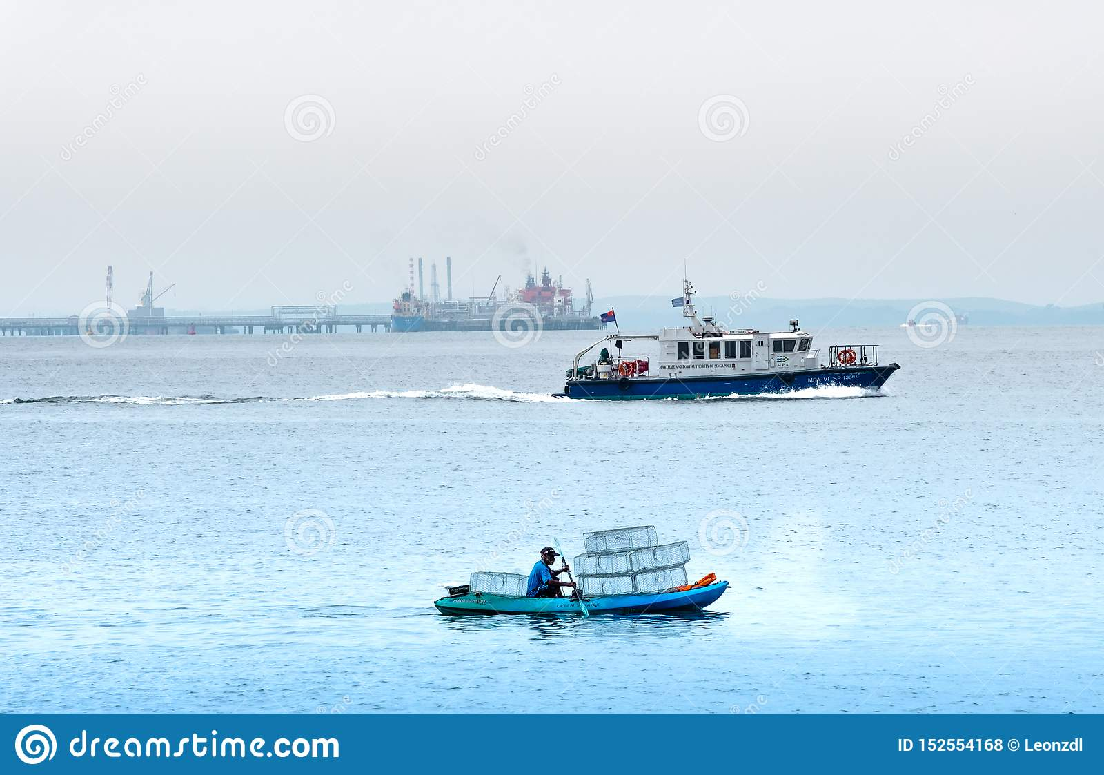 Singapore-29 JUN 2019:Fisherman is fishing in the sea by placing cages