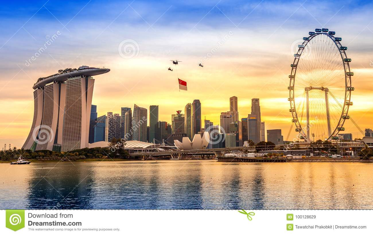 Singapore National Day helicopter hanging Singapore flag flying over the city