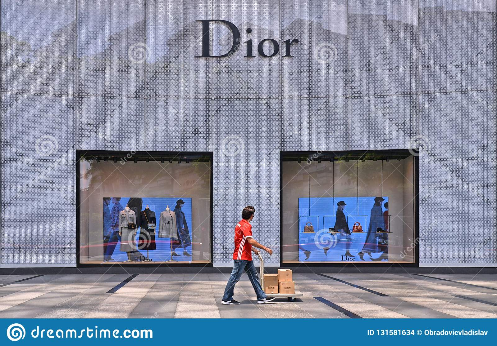 Orchard shopping mall on Orchard Road in Singapore modern district. worker passes with packages