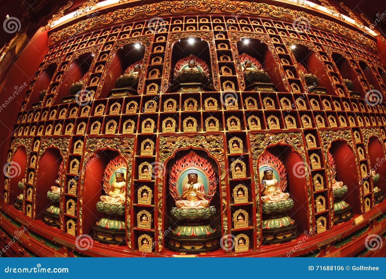 SINGAPORE/SINGAPORE - 27 MAR, 2014 : Red Chinese temple, Buddha