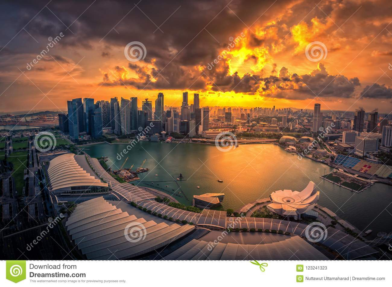 Singapore Skyline and view of skyscrapers on Marina Bay at sunset.