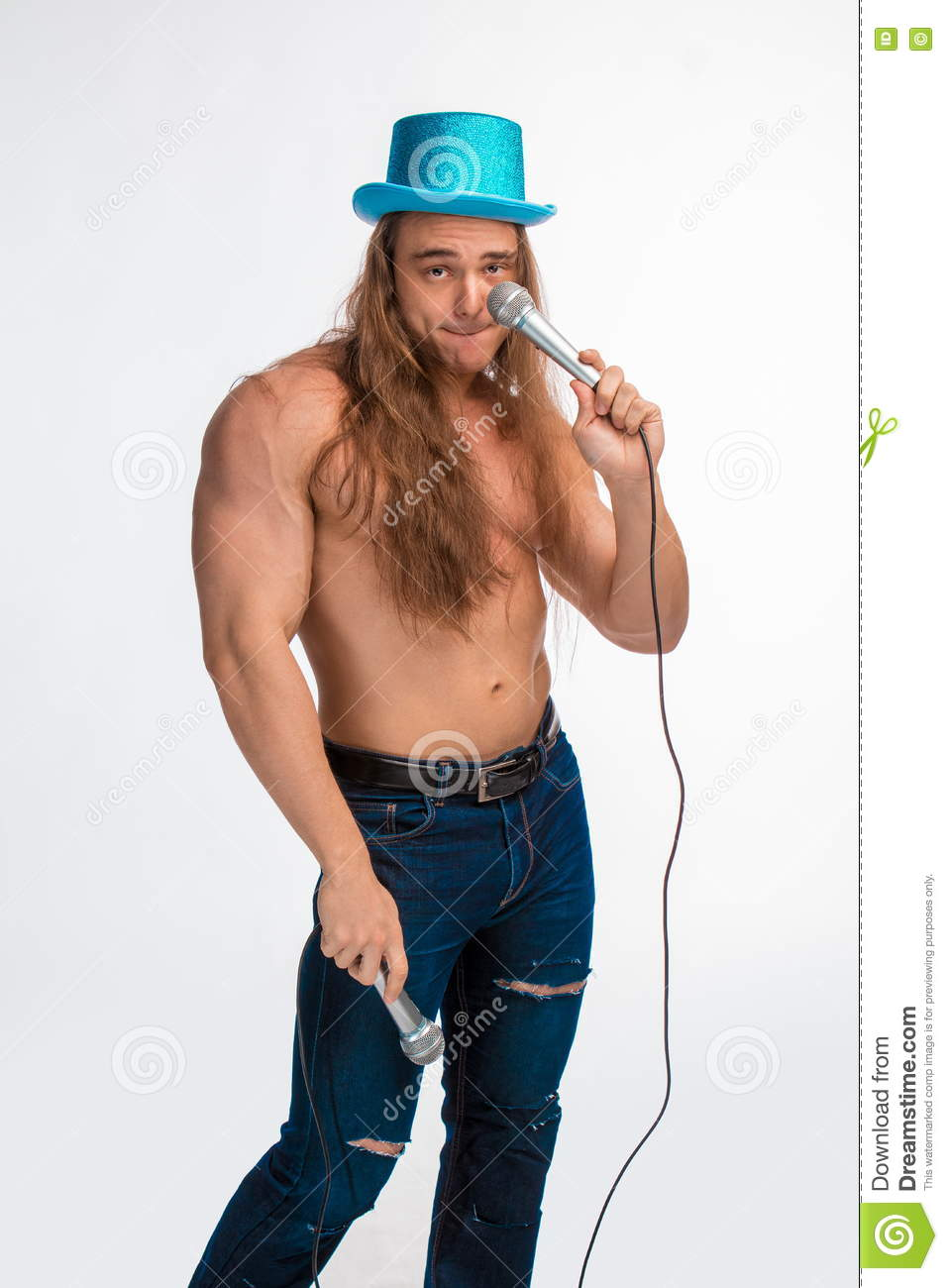 Singer bodybuilder shirtless with long hair in a blue hat with a microphone 873cdf0df85