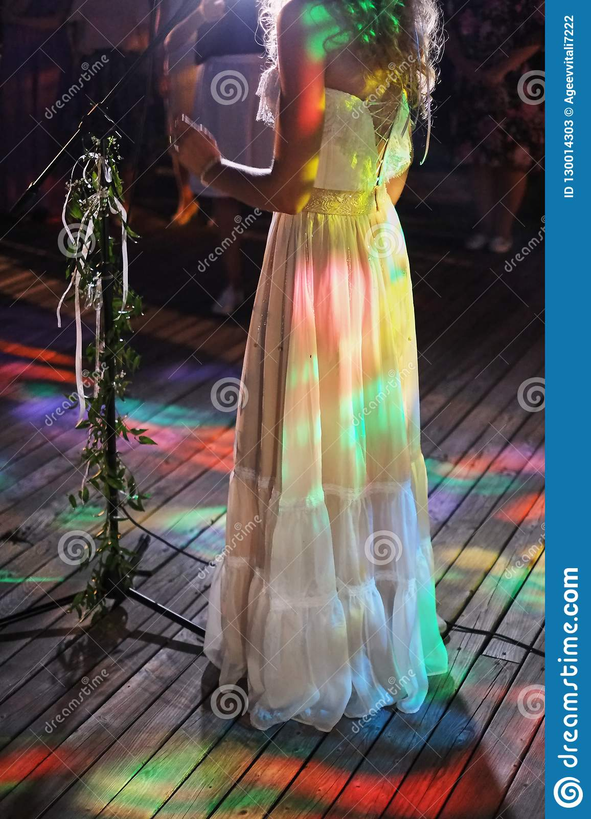 Singer woman on stage. bride sings a song at a wedding party. party lights