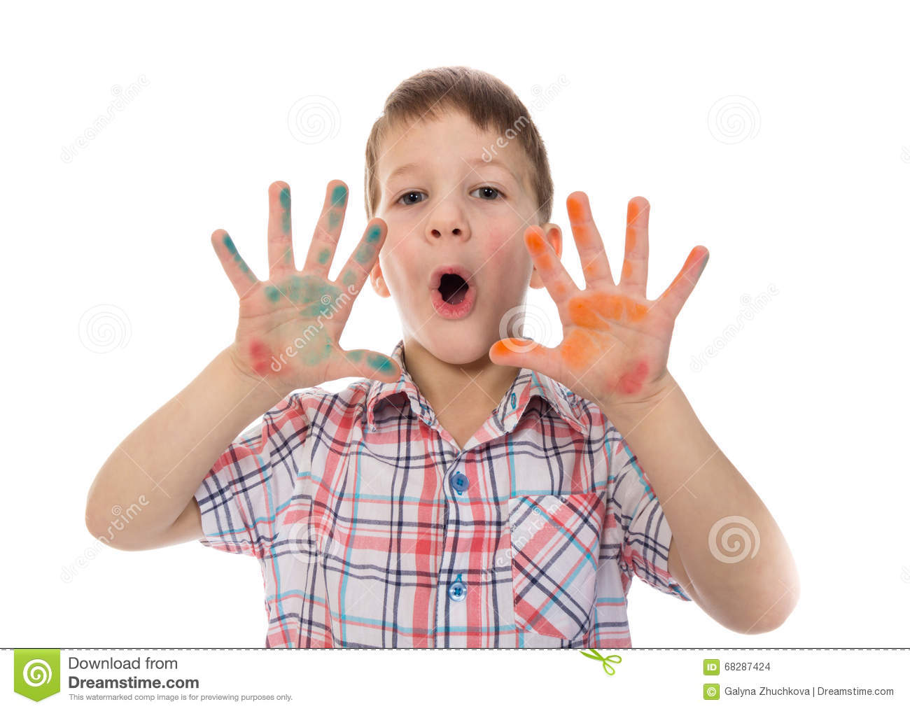 Singing boy with colorful painted fingers spread