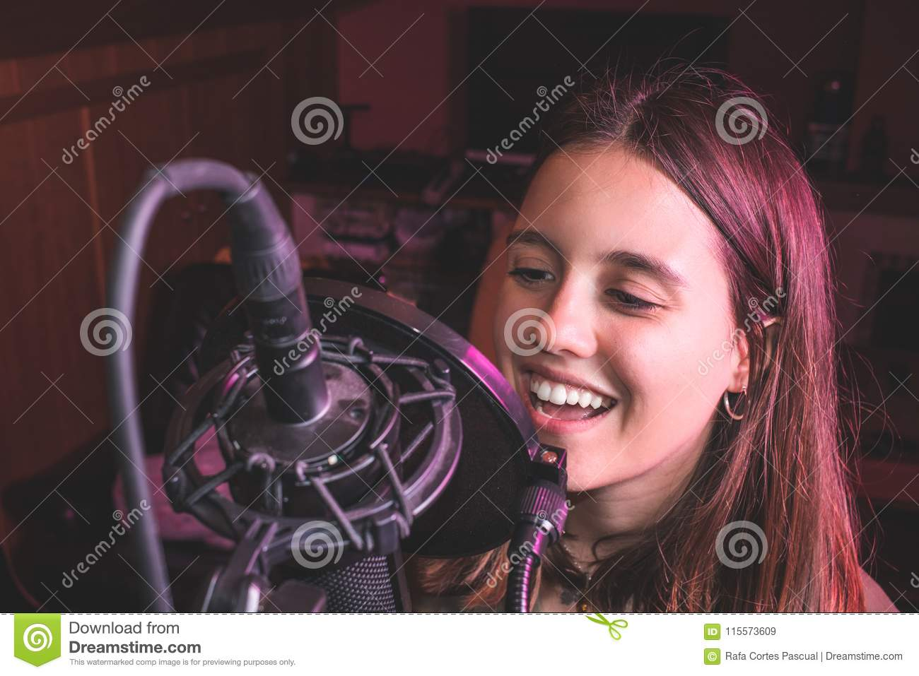 Singing girl singing with a microphone