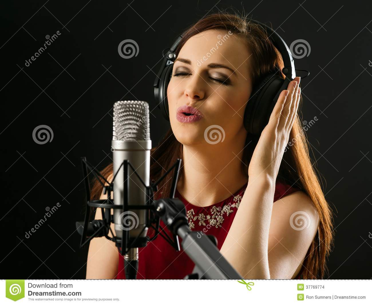 Singing into a studio microphone stock photo image of for A beautiful you at vesuvio salon studios