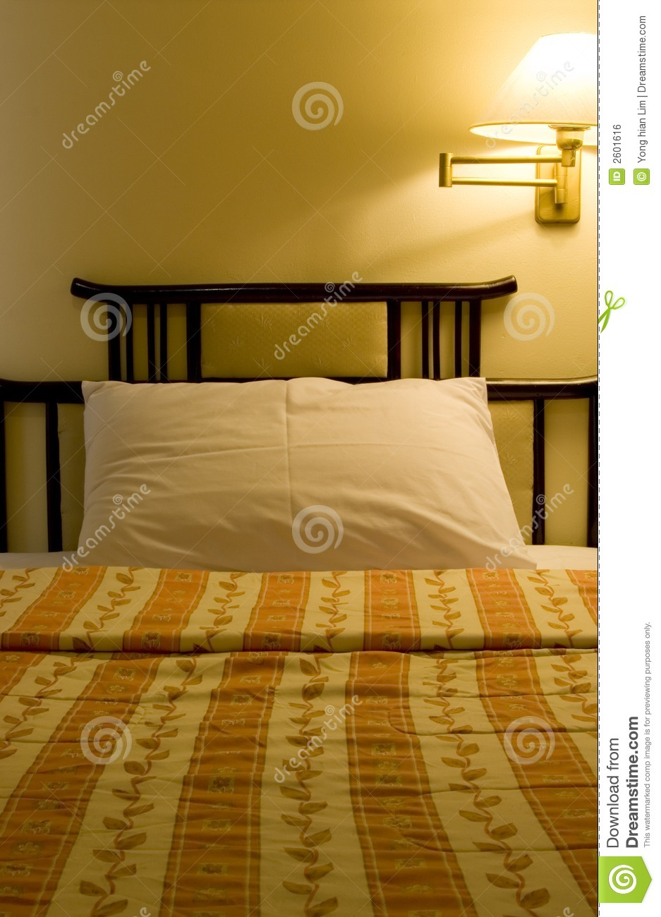 Single Bed In A Hotel Room Royalty Free Stock Image