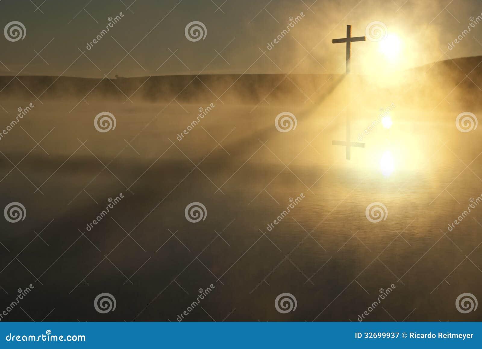 Single Cross Long Shadow Sunrise on Foggy Lake Eas