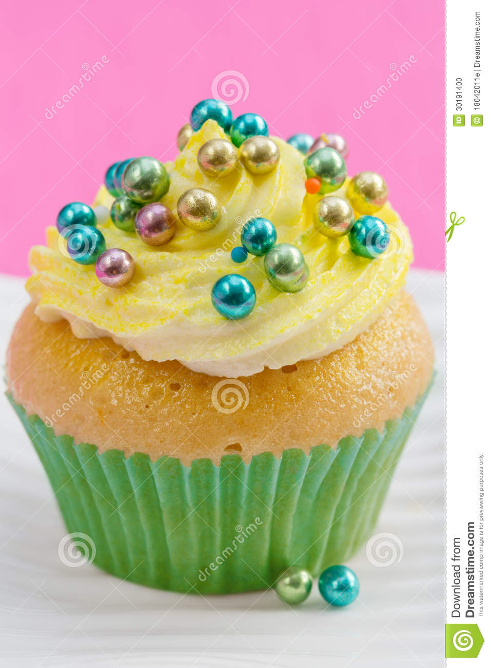 Single Cupcake With Yellow Buttercream And Colorful