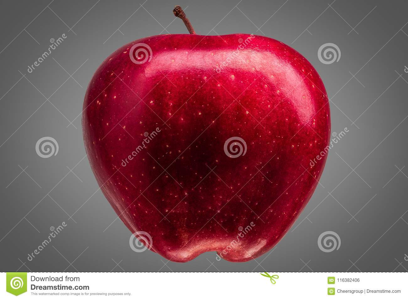 Single delicious red apple on grey background
