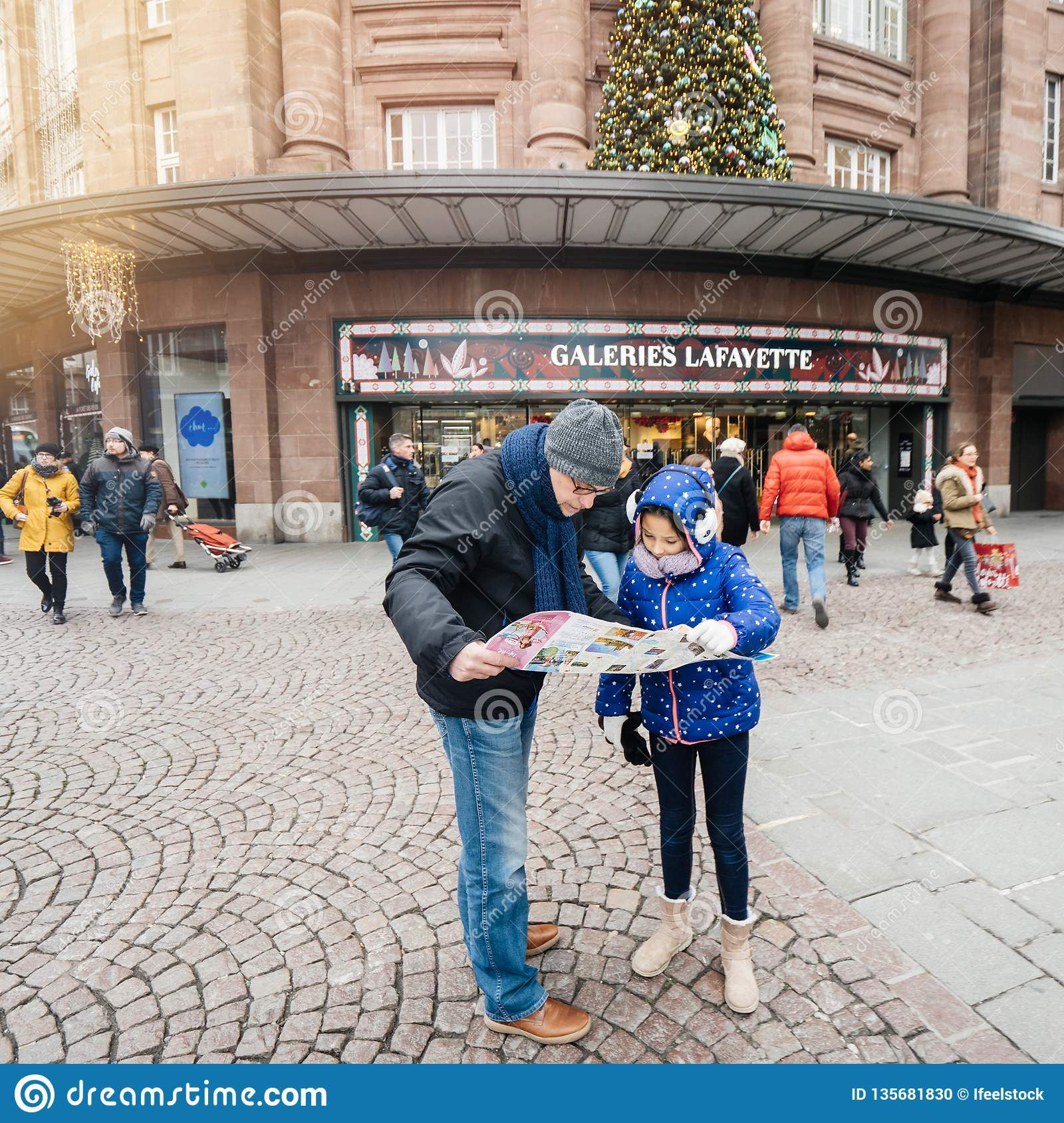 Single Father With Daughter Reading Map In City Center Editorial ...