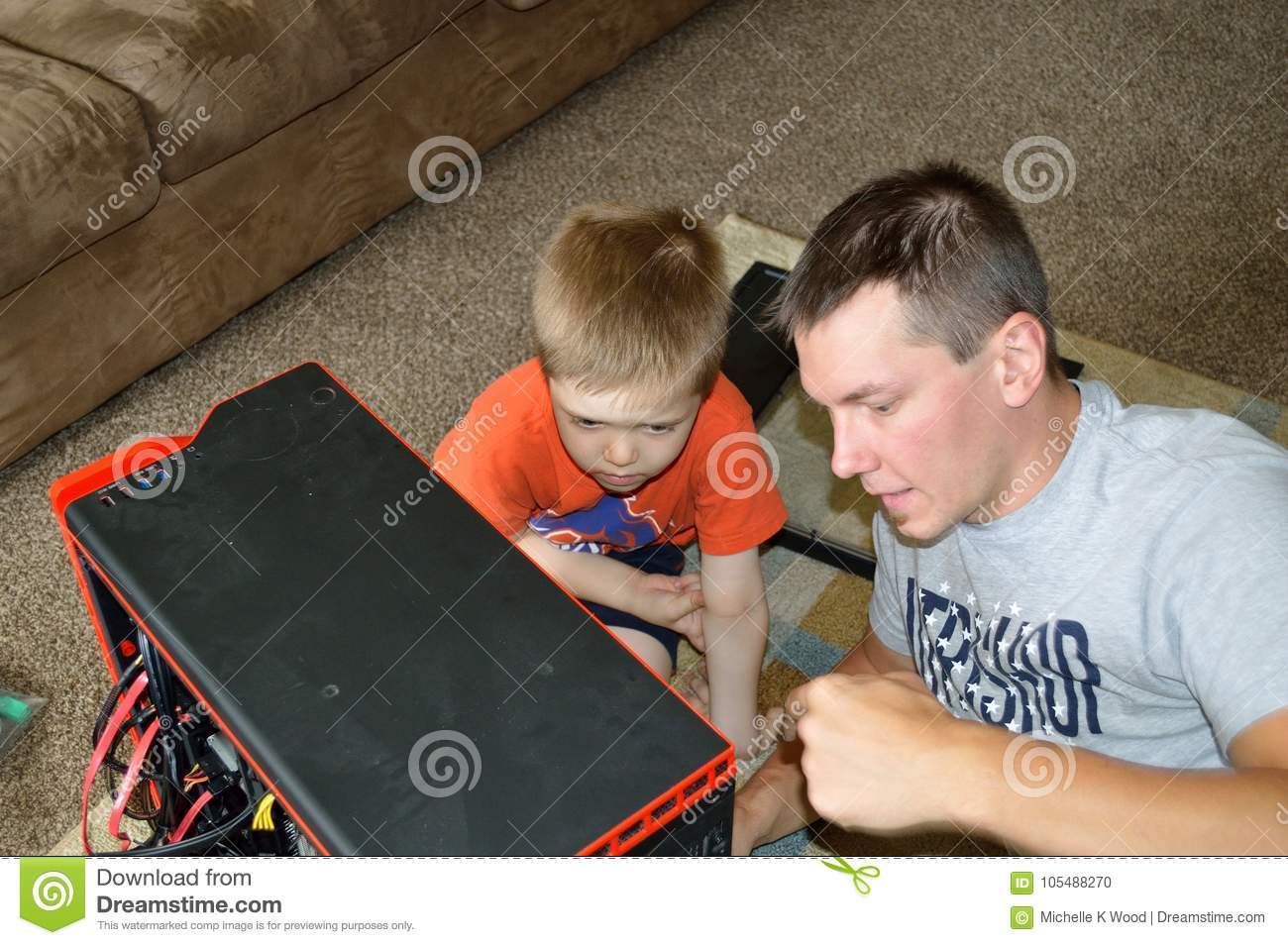 Single Father and Son Fixing Computer