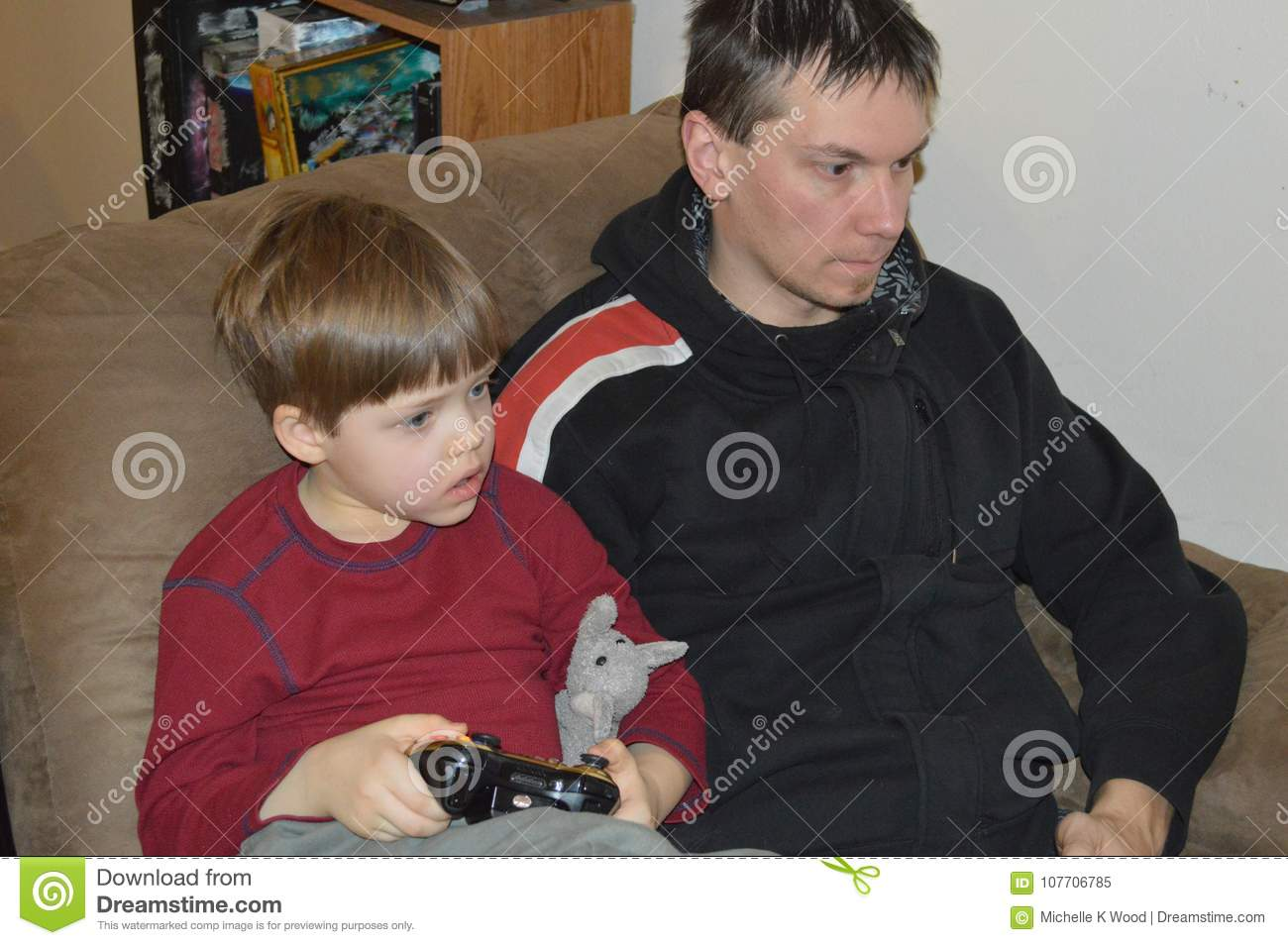 Single father and son play video games