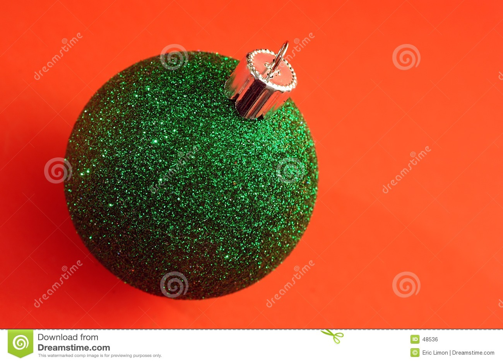 A single green Christmas Ornament