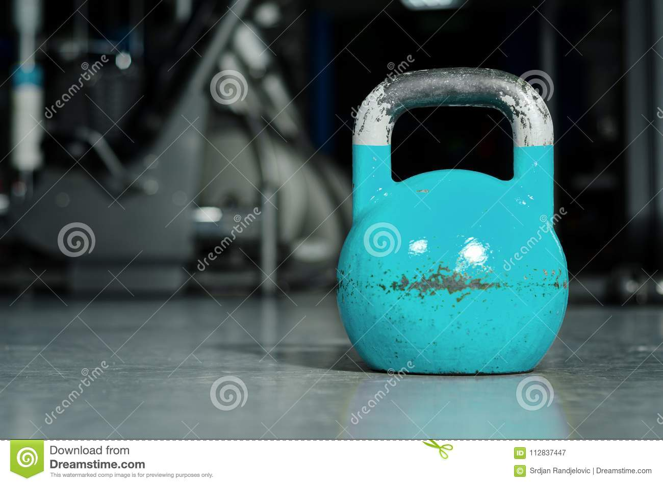 Single Kettlebell On The Gym Floor Ready To Use For Strength