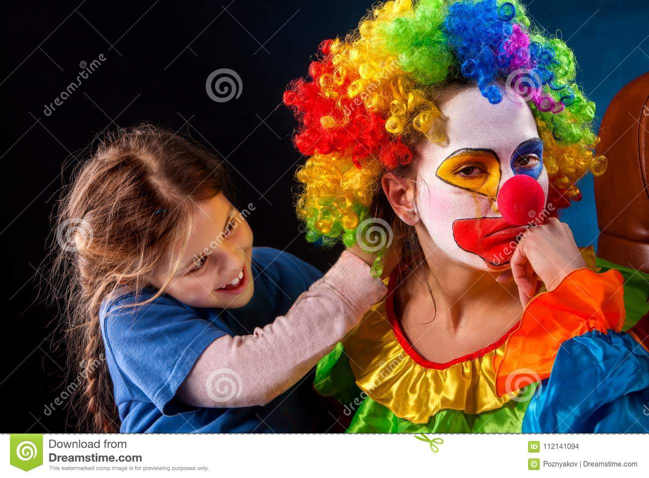 Single parent family. Mom after work birthday clown. Adult child relationship.