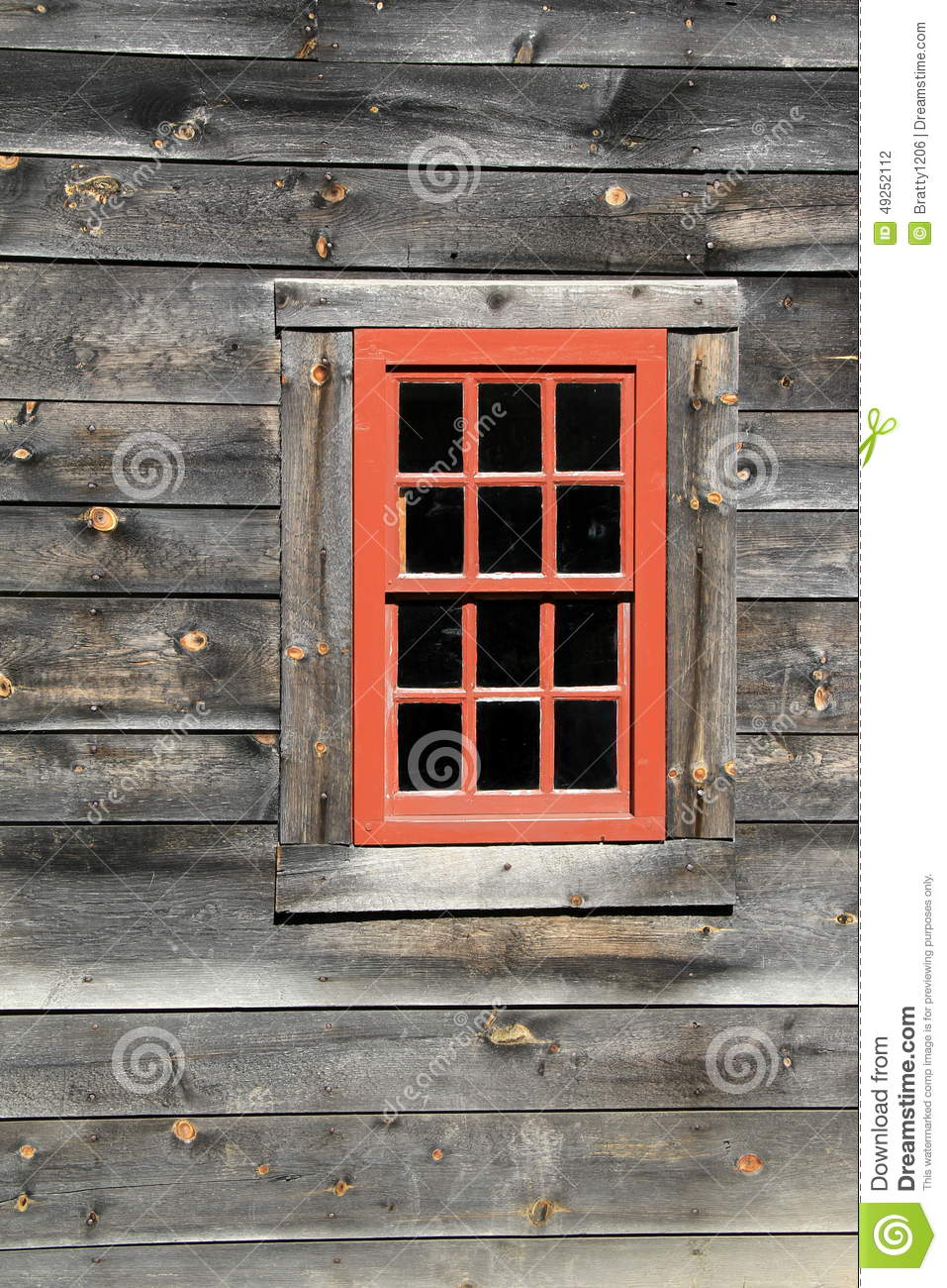Single Red Window With Twelve Panes Of Glass In Weathered