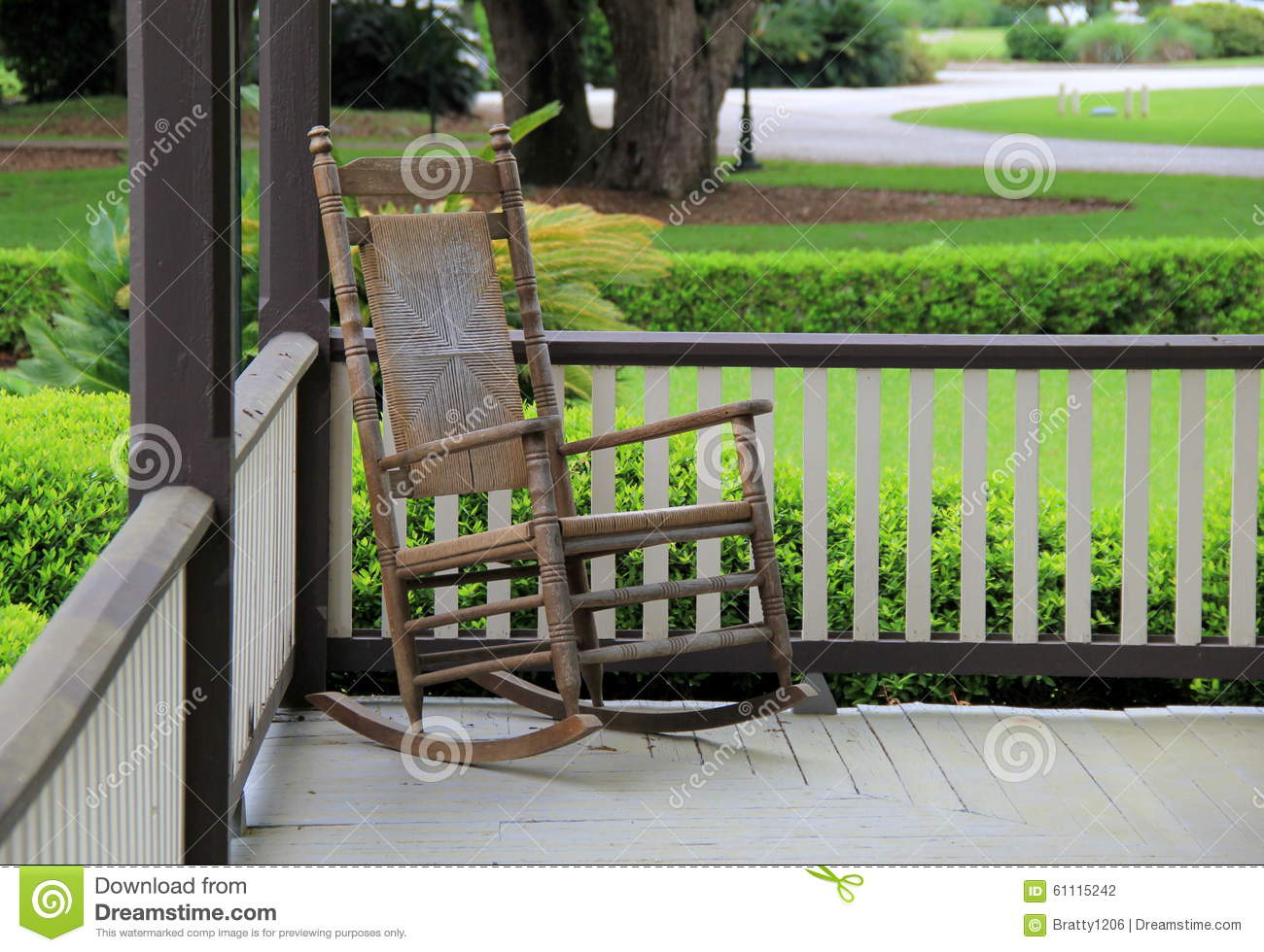 Sensational Single Rocking Chair On Country Porch Stock Photo Image Of Inzonedesignstudio Interior Chair Design Inzonedesignstudiocom