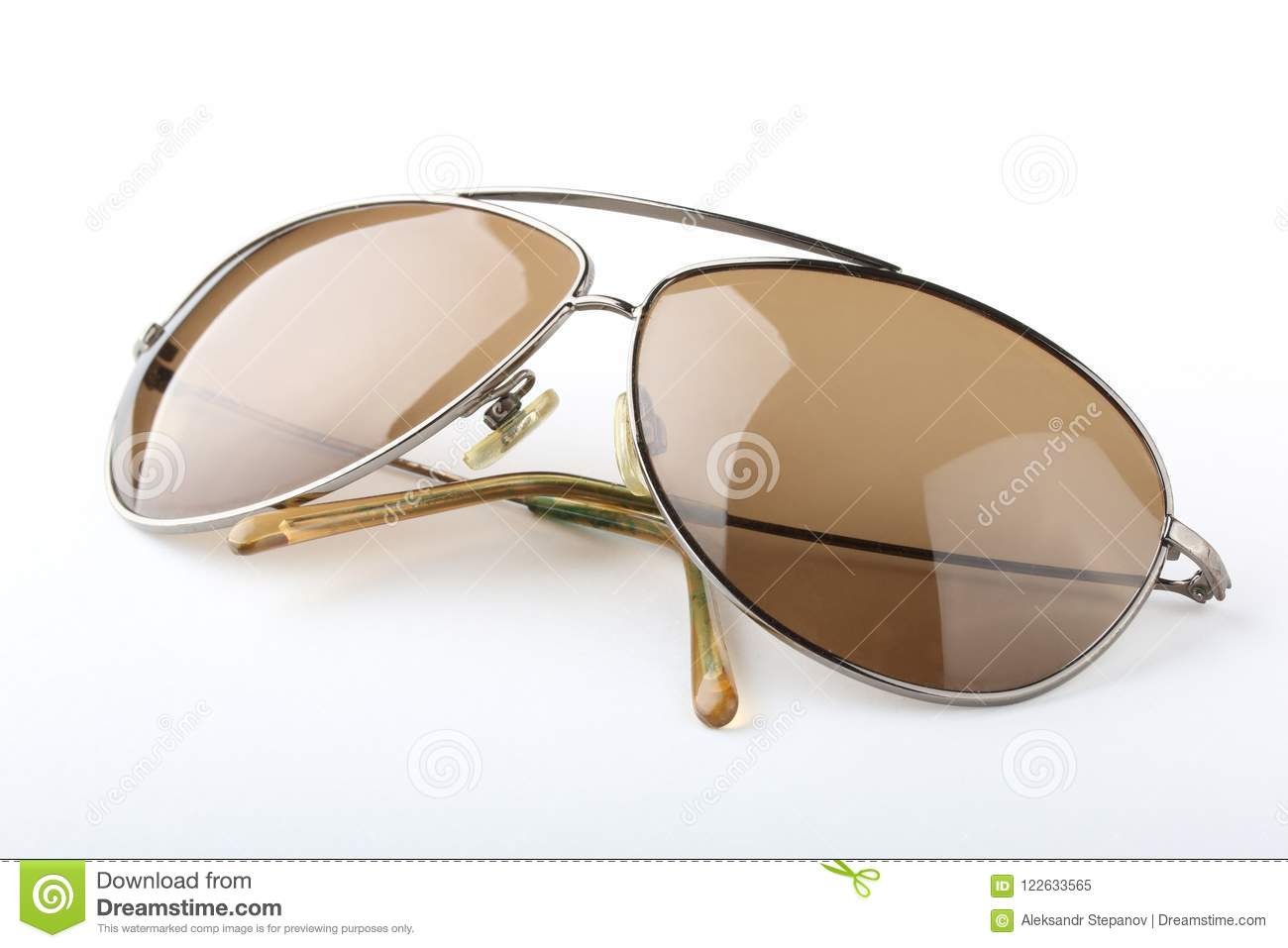 Old Scratched Classic Sunglasses With Metal Frame And Brown Lenses ...