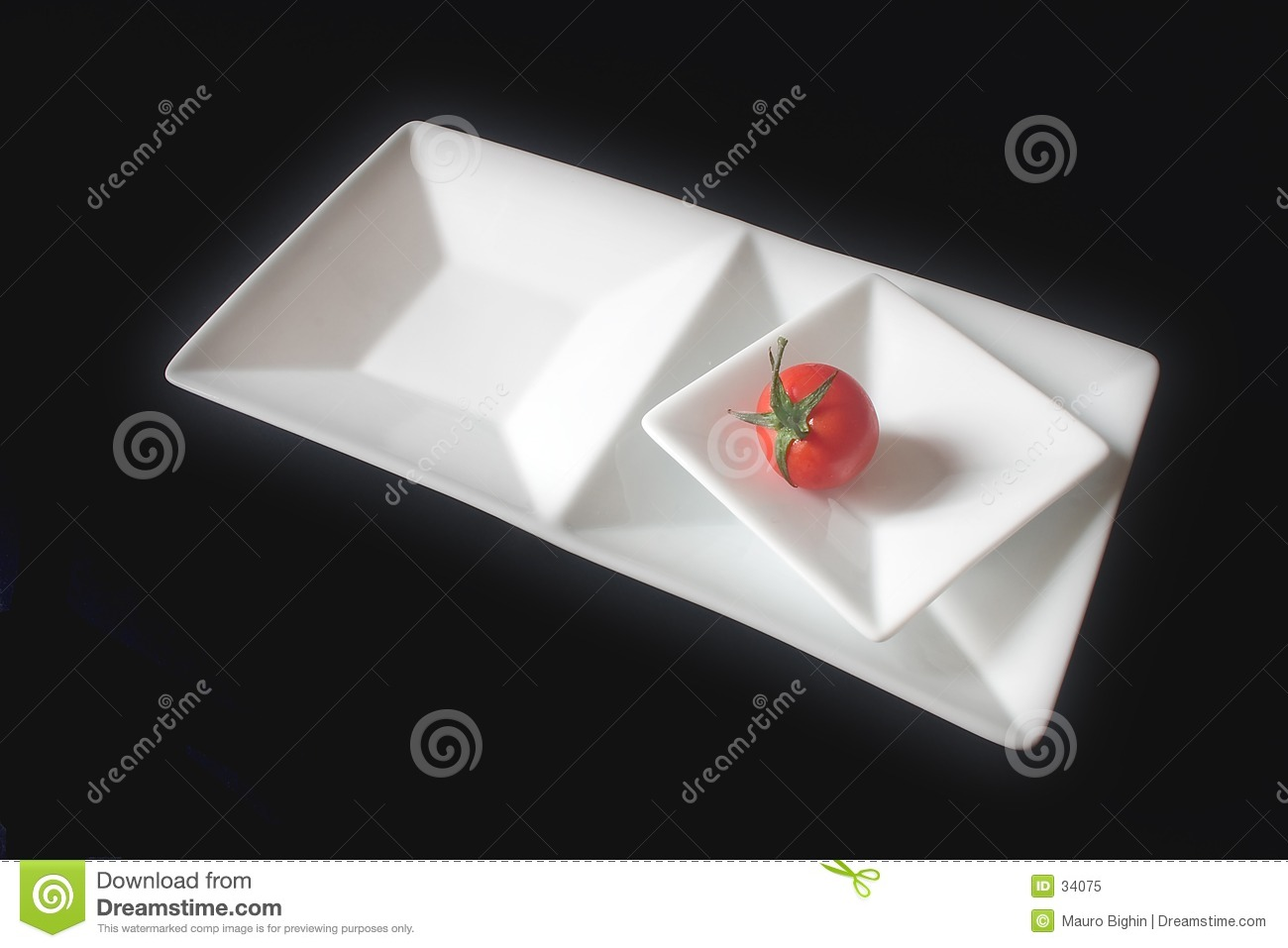 Single tomato on squared dishes