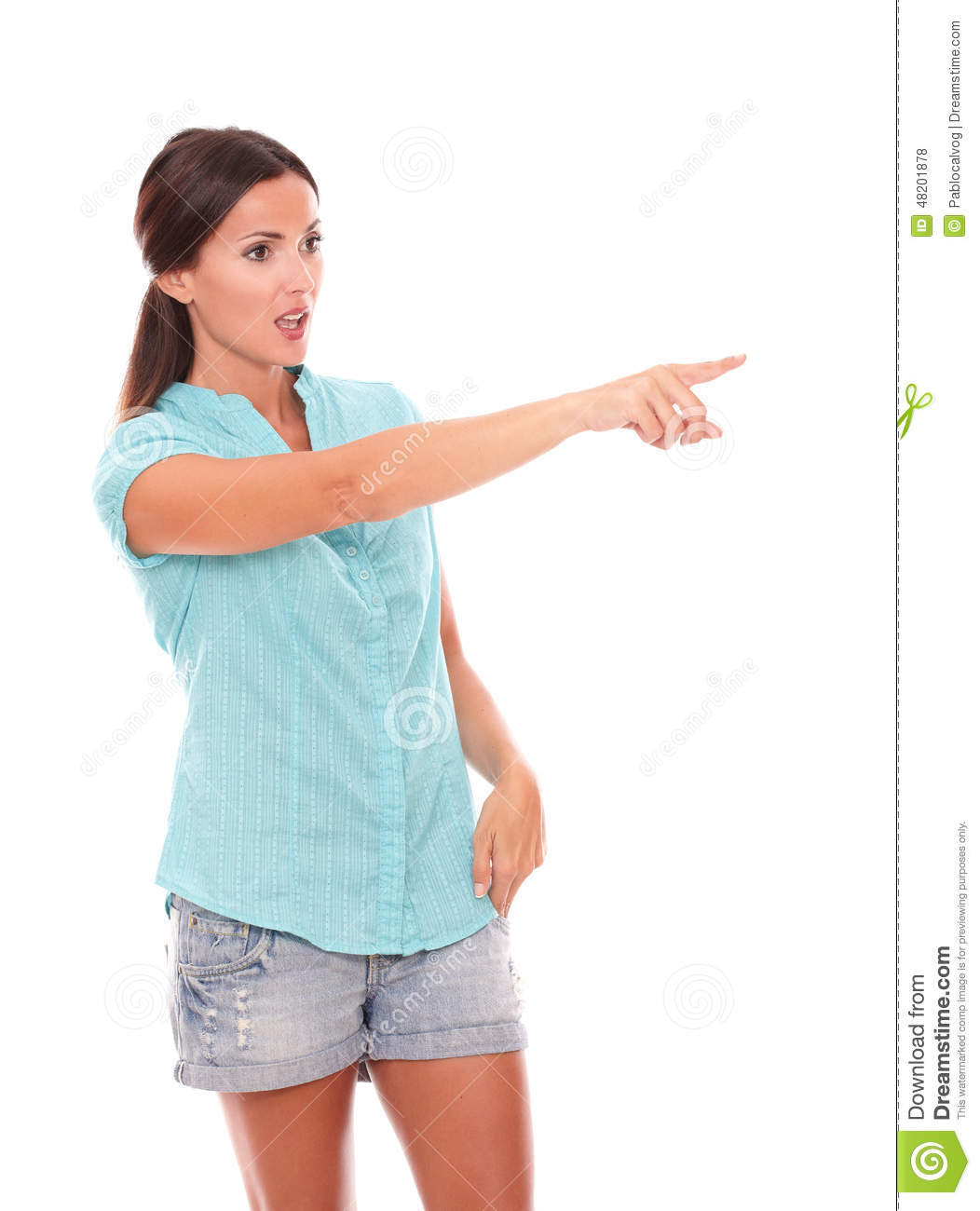 Single woman in short jeans pointing to her left