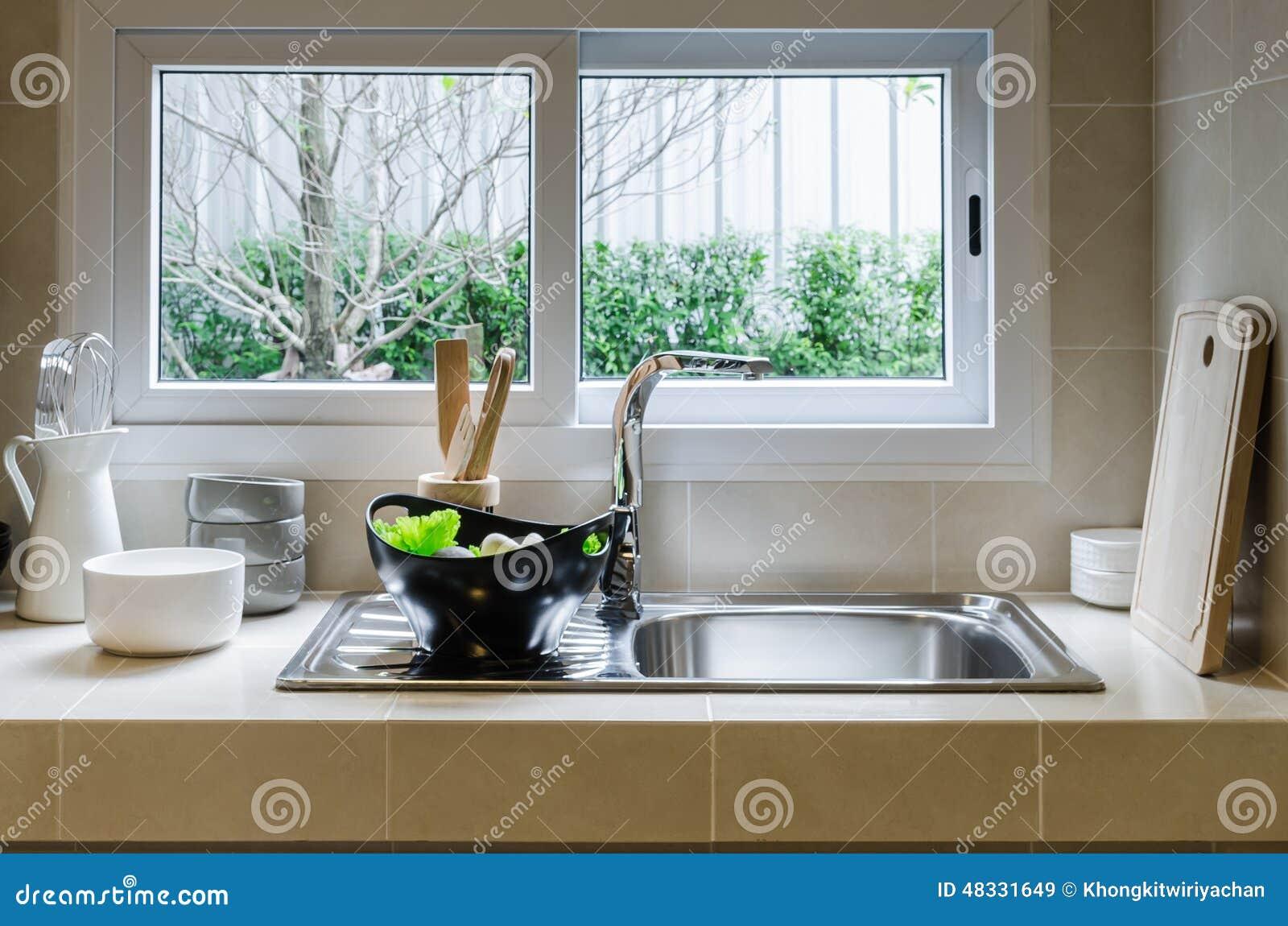 Cucine Con Finestra Sul Lavello sink and counter in kitchen stock image - image of
