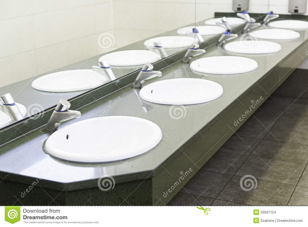 Sinks in a public bathroom stock photo. Image of pure - 50597154