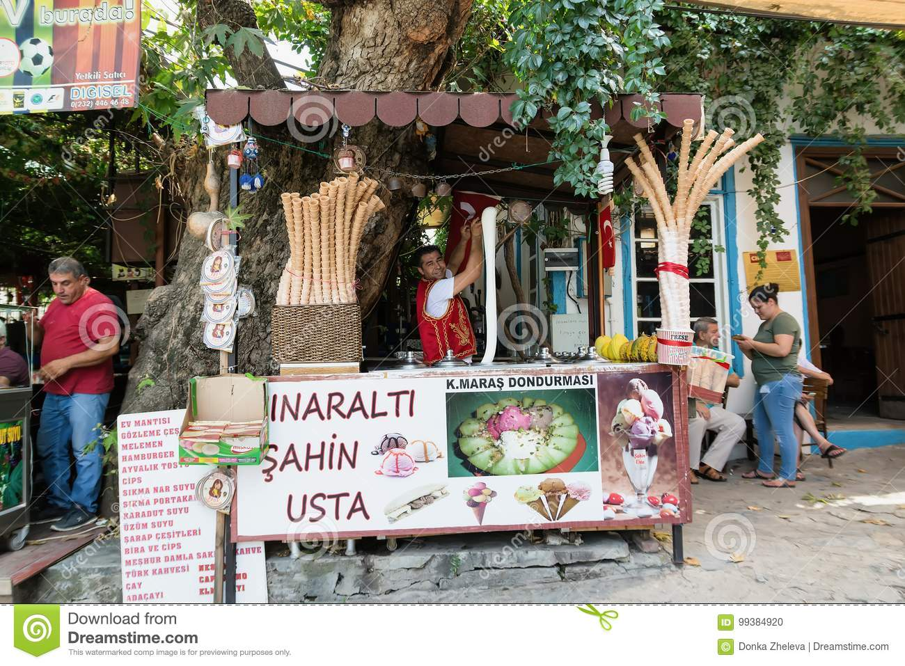 SIRINCE, TURKEY - AUGUST 17, 2017: A man in traditional Turkish costume sells ice cream on the street