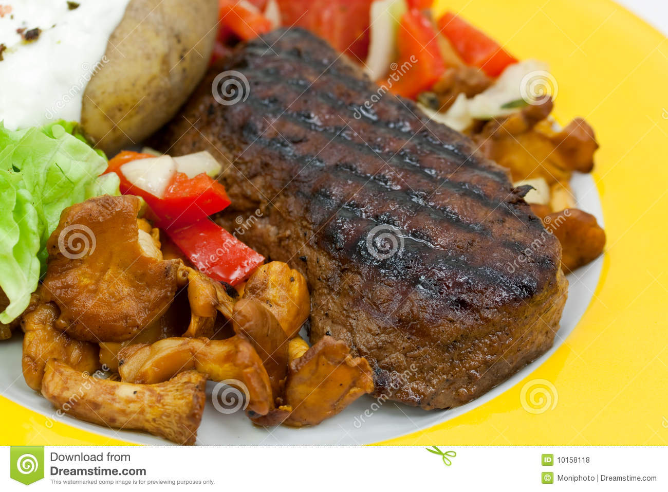 Sirloin strip steak with baked potato and chantere