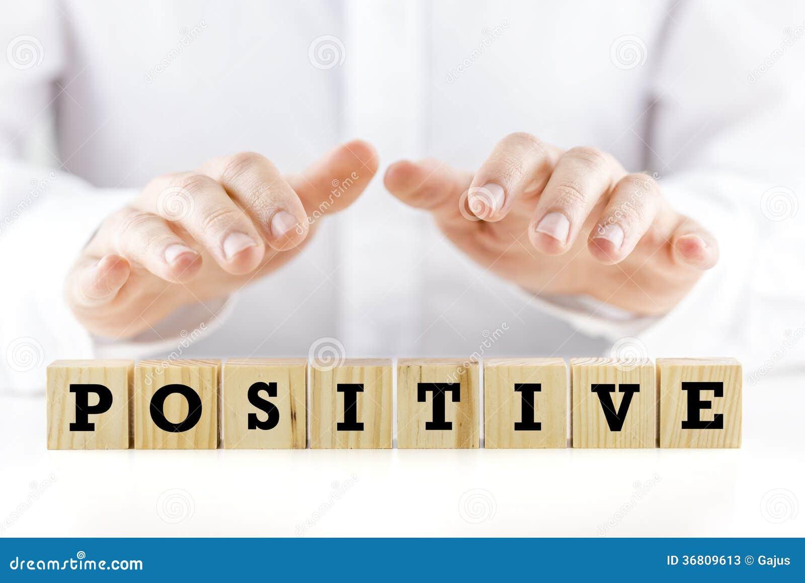 Sirva llevar a cabo sus manos sobre el positivo de la palabra