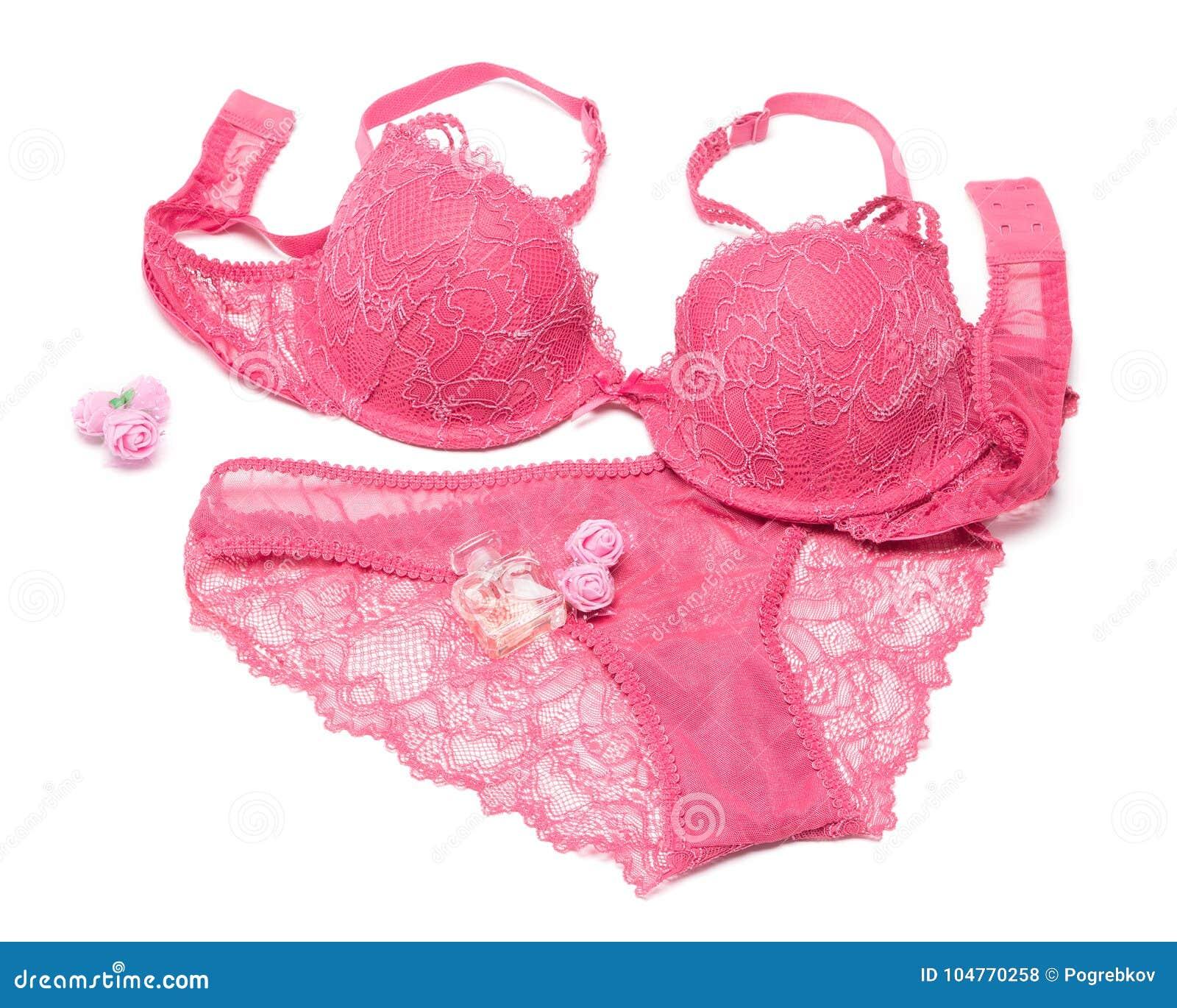 e56e6759ab Sistema de la lencería sexy del sujetador y de las bragas con perfume y  pequeñas flores color de rosa en el fondo blanco Accesorios atractivos de la  mujer