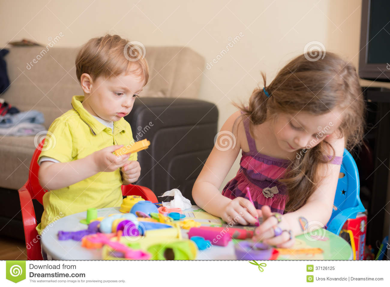 Sister And Brother Playing At Home Royalty Free Stock