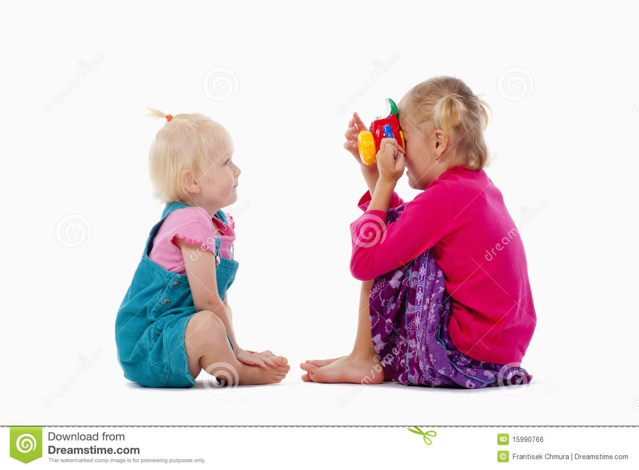 Toys For Siblings : Sister and toy camera royalty free stock image