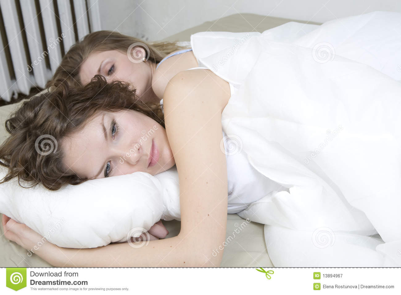 Sisters Cuddling In Bed Royalty Free Stock Photography - Image ...