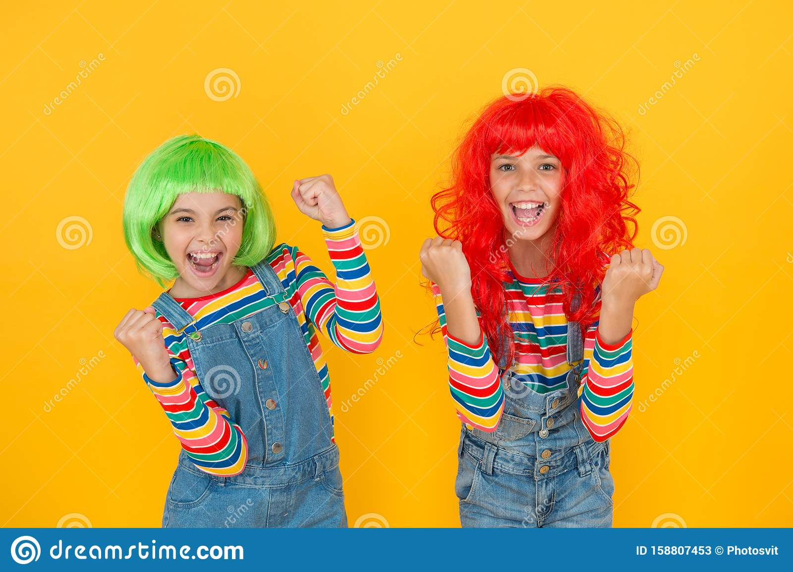 Sisters having fun. Semi permanent color cream. Colored clip in hair extensions. Change color. Kids girls with vibrant