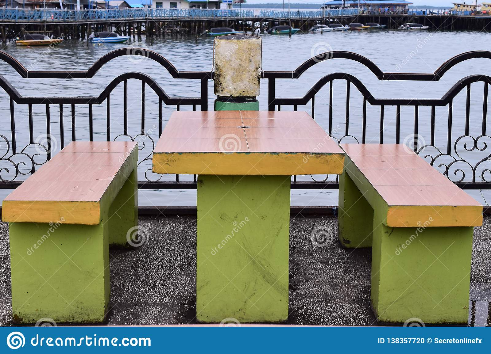 Sit bench in a public place and bridge over the river