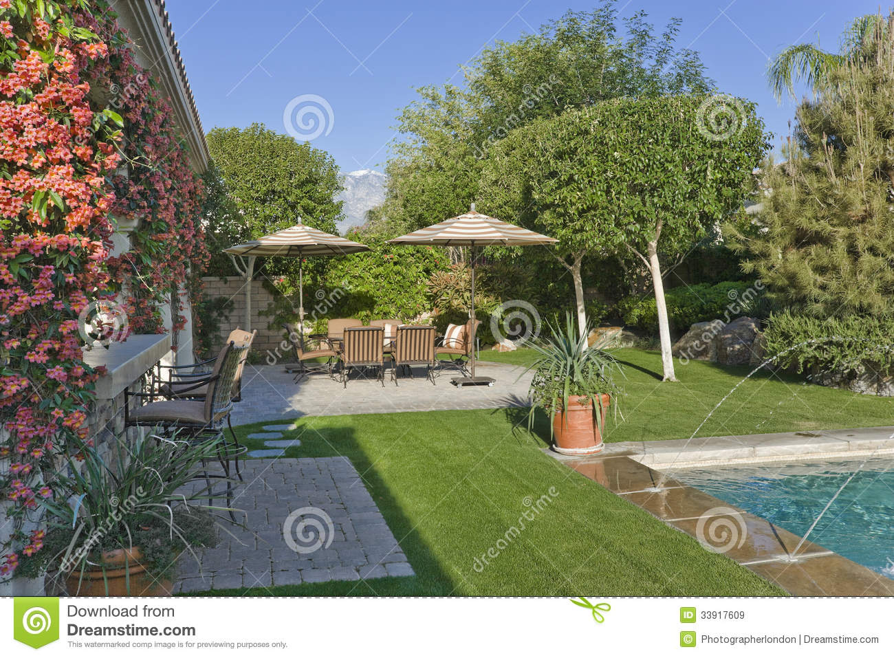 sitting area by pool in house backyard royalty free stock images