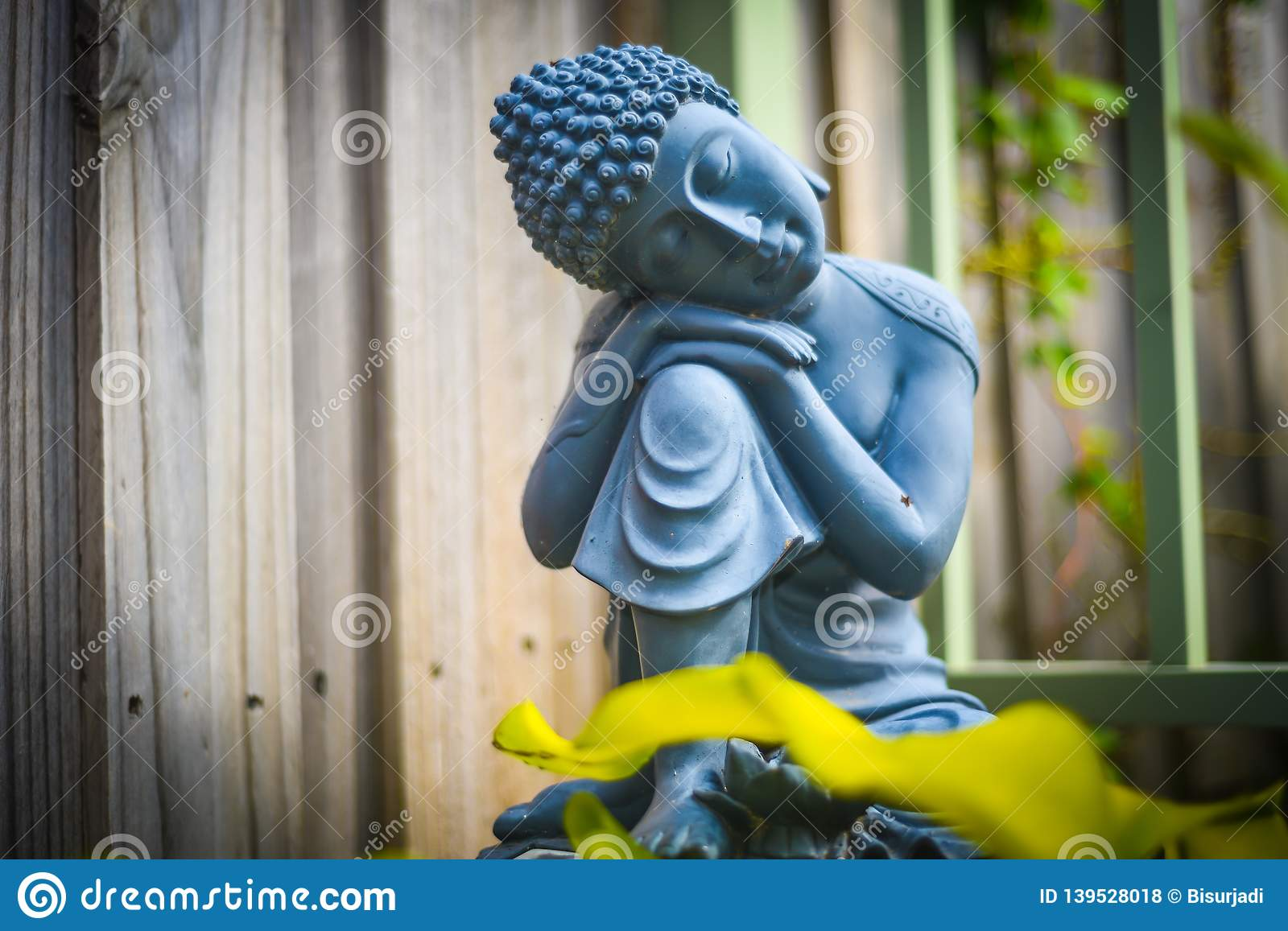 Black And White Stone Statue Of Sitting Buddha In The Garden Stock